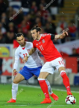 Gareth Bale of Wales shields the ball from Aleksandar Jovanovic of Serbia - Wales v Serbia, FIFA 2018 World Cup Qualifying Group D, Cardiff City Stadium, Cardiff - 12th November 2016.