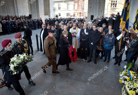 British Ambassador to Belgium, Alison Rose, center, prepares to place a poppy wreath during an Armistice Day ceremony at the Menin Gate in Ypres, Belgium on . The Menin Gate Memorial bears the names of more than 54,000 British and Commonwealth soldiers who were killed in the Ypres Salient of World War I and whose graves are not known
