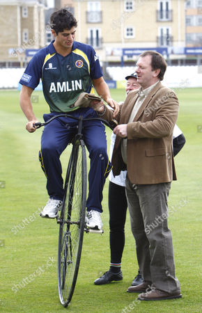 Cricket - Division One - Essex County Cricket Photo Call Alastair Cook of Essex County Cricket with Lloyd Scott MBE on a Penny farthing bicycle at The Ford County Ground Chelmsford