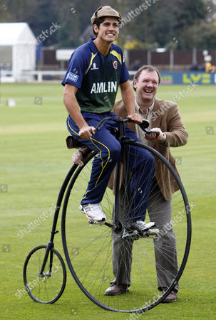 Cricket - Division One - Essex County Cricket Photo Call Alastair Cook of Essex County Cricket with Lloyd Scott on a Penny farthing bicycle at The Ford County Ground Chelmsford