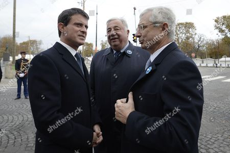 French Prime Minister Manuel Valls, French Senate President Gerard Larcher and French National Assembly President Claude Bartolone during the commemoration of the 98th anniversary of 1918 Armistice Day in Paris