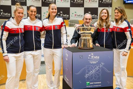Jean Gachassin, head of the French Tennis Federation, poses with French players and captain Amelie Mauresmo, right, during the Fed Cup final draw in Strasbourg, eastern France