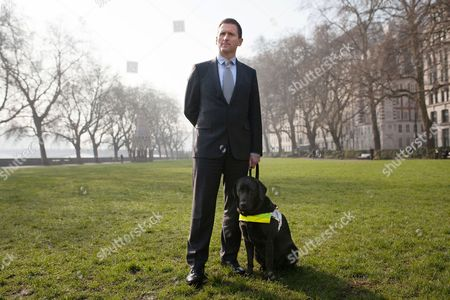 Chris Holmes of Richmond stands with Lottie his guide dog at Victoria Tower Gardens