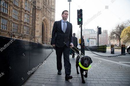 Chris Holmes of Richmond stands with Lottie his guide dog
