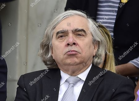 United States Secretary of Energy Dr. Ernest Moniz looks on as US  Barack Obama makes remarks in the Memorial Amphitheater at Arlington National Cemetery in Arlington, Virginia after laying a wreath at the Tomb of the Unknown Soldier on Veteran's Day,.