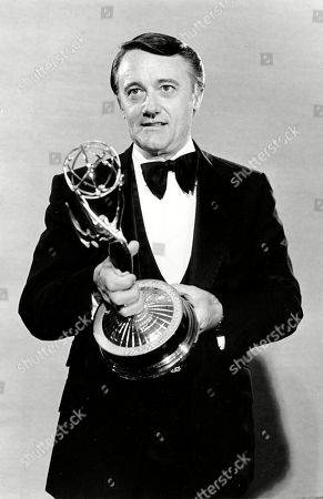 "Stock Picture of Actor Robert Vaughn poses with his Emmy Award for outstanding supporting actor for a drama series in ""Washington: Behind Closed Doors."" during the 31st Annual Primetime Emmy Award presentation in Los Angeles, Calif. Vaughn, the debonair crime-fighter of television's ""The Man From U.N.C.L.E."" in the 1960s, died, after a brief battle with acute leukemia. He was 83"