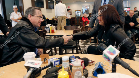 Mark Kirk, Tammy Duckworth Sen Mark Kirk, R-Ill., left, shakes hands with Sen.-elect Tammy Duckworth, D-Ill., at the end of their meeting at a local deli, in Chicago. It was their first meeting since she defeated the incumbent Kirk in Tuesday's election