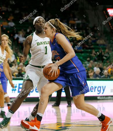 Baylor forward Dekeiya Cohen (1) defends as Houston Baptist forward Lauren Calver (23) drives to the basket in the first half of an NCAA college basketball game, in Waco, Texas
