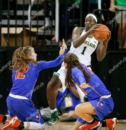 Baylor forward Dekeiya Cohen (1) collects the ball against Houston Baptist's Sophie Taylor (12) and Taylor Kollmorgen, right, in the second half of an NCAA college basketball game, in Waco, Texas