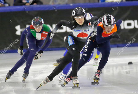 Sumire Kikuchi, Lucia Peretti, Lara van Ruijven Japan's Sumire Kikuchi, center, races to the finish line as Itay's Lucia Peretti, left, and Netherlands' Lara van Ruijven, right, pursue during the women's 500 meters at a World Cup short track speedskating event, at the Utah Olympic Oval, in Kearns, Utah