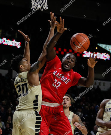 Randy Phillips (32) of the Radford Highlanders gets fouled John Collins (20) of the Wake Forest Demon Deacons in the NCAA Basketball matchup between the Radford Highlanders and the Wake Forest Demon Deacons at LJVM Coliseum in Winston-Salem, NC
