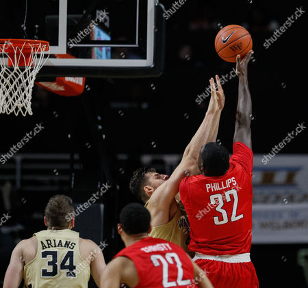 Randy Phillips (32) of the Radford Highlanders gets the layup over Konstantinos Mitoglou (44) of the Wake Forest Demon Deacons in the NCAA Basketball matchup between the Radford Highlanders and the Wake Forest Demon Deacons at LJVM Coliseum in Winston-Salem, NC