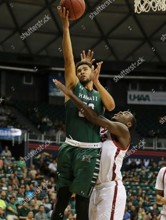 Noah Allen, Brandon Jackson Hawaii guard Noah Allen (32) makes a layup over SIU Edwardsville forward Brandon Jackson (32) during the first half of the NCAA college basketball game, in Honolulu