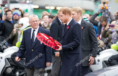 Prince Harry (R) with Lewis Moody (R) as he lays a wreath for remembrance day at the Rose and Poppy Gates before the match