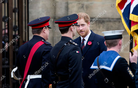 Prince Harry chats with the guard of honour after he lays a wreath for remembrance day at the Rose and Poppy Gates before the match RFU President Peter Baines (R) with Lewis Moody
