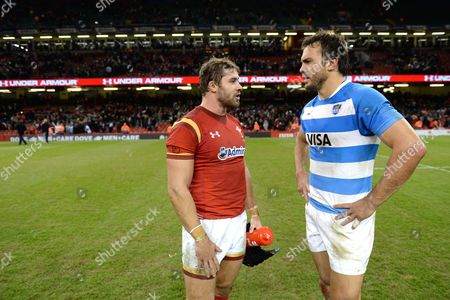 Leigh Halfpenny of Wales and Juan Martin Hernandez of Argentina at the end of the game.