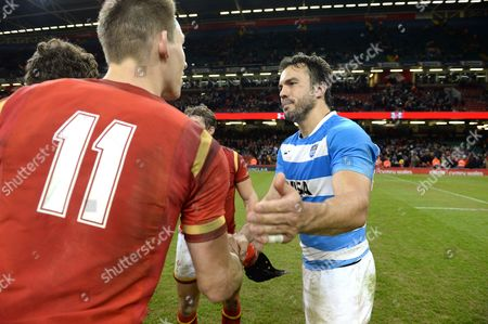 Liam Williams of Wales and Juan Martin Hernandez of Argentina at the end of the game.
