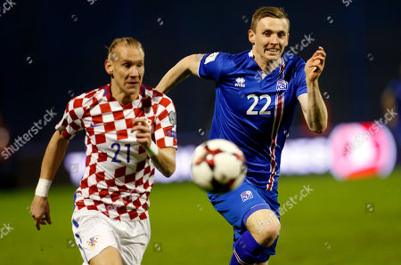 Iceland's Eidur Gudjohnsen, right, is chalenged by Croatia's Domagoj Vida during the World Cup Group I qualifying soccer match between Croatia and Iceland, at Maksimir stadium in Zagreb, Croatia