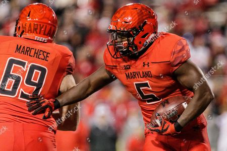 th, Maryland Terrapins running back Wes Brown (5) rushes the ball while Maryland Terrapins offensive lineman Joe Marchese (69) blocks during NCAA football game action between the Ohio State Buckeyes and the Maryland Terrapins at Maryland Stadium, College Park, MD