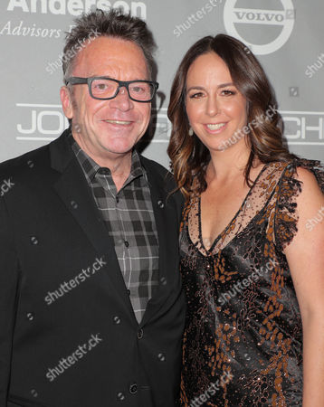 Stock Image of Tom Arnold and Ashley Groussman