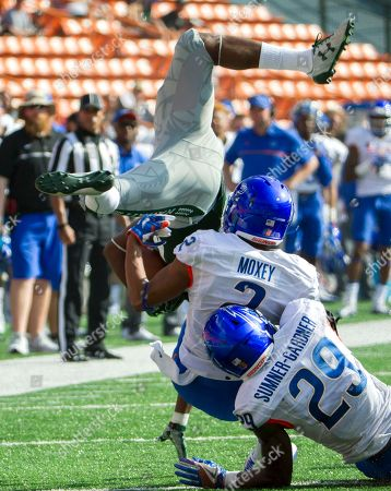 Paul Harris, Jonathan Moxey, Dylan Sumner-Gardner Hawaii running back Paul Harris, left, is upended by Boise State cornerback Jonathan Moxey (2) and his teammate safety Dylan Sumner-Gardner (29) in the first half of an NCAA college football game, in Honolulu