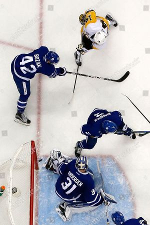Chris Kunitz, Frederik Andersen Pittsburgh Penguins' Chris Kunitz (14) gets a shot past Toronto Maple Leafs goalie Frederik Andersen (31) for a goal during the second period of an NHL hockey game in Pittsburgh, . The Penguins won 4-1