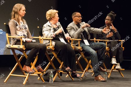 Stock Photo of Filmmakers Abby Ginzberg and Frank Dawson (center) on a panel after screening of their film 'Agents of Change' at NYC Documentary Film Festival at School of Visual Arts Theater.