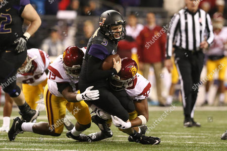 Washington's quarterback Jake Browning (3) is sacked by Southern California's linebacker Uchenna Nwosu (42) and Southern California's linebacker Michael Hutchings (19) during a game between the USC Trojans and the Washington Huskies at Husky Stadium in Seattle, WA on , 2016. Southern California won 26-13
