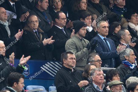 French President, Francois Hollande, President of the FFF, Noel Le Graet, Sports Minister Patrick Kanner, Annick Girardin and Jean-Vincent Place observe a minute of silence in memory of the victims of the Nov.13, 2015 Paris attacks, before the World Cup Group A qualifying soccer match between France and Sweden at the Stade de France stadium