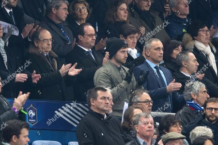 French President, Francois Hollande, President of the FFF, Noel Le Graet, Sports Minister Patrick Kanner, Annick Girardin and Jean-Vincent Place observe a minute of silence in memory of the victims of the Nov.13, 2015 Paris attacks, before the World Cup Group A qualifying soccer match between France and Sweden at the Stade de France stadium in Saint-Denis