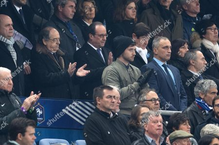 French President, Francois Hollande, President of the FFF, Noel Le Graet, Sports Minister Patrick Kanner, Annick Girardin and Jean-Vincent Place observe a minute of silence in memory of the victims of the Nov.13, 2015 Paris attacks, before the World Cup Group A qualifying soccer match between France and Sweden
