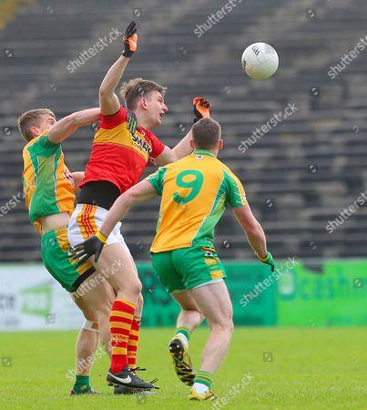 Castlebar Mitchels vs Corofin. Corofin?s Kieran Fitzgerald and Ronan Steede with Barry Moran of Castlebar