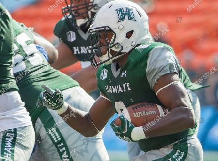 Paul Harris Hawaii running back Paul Harris, center, looks for an opening to cut up field in the first quarter of an NCAA college football game, in Honolulu