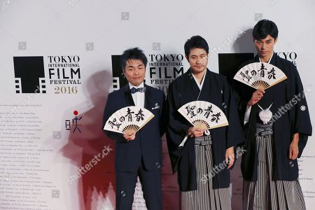 Stock Picture of Kenichi Matsuyama, Yoshitaka Mori, Masahiro Higashide Film director Yoshitaka Mori, left, Japanese actors Kenichi Matsuyama, center, and Masahiro Higashide pose for photographers on the red carpet during Tokyo International Film Festival opening ceremony in Tokyo. The devotion Matsuyama gave to portraying a shogi prodigy who lived a fearlessly single-minded life is clear in the months he spent practicing placing the pawns in the Japanese board game, immersing himself in the master's selfless view on death and gorging to gain weight