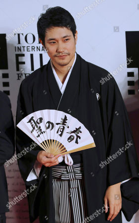 Kenichi Matsuyama Japanese actor Kenichi Matsuyama poses for photographers on the red carpet during Tokyo International Film Festival opening ceremony in Tokyo. The devotion Matsuyama gave to portraying a shogi prodigy who lived a fearlessly single-minded life is clear in the months he spent practicing placing the pawns in the Japanese board game, immersing himself in the master's selfless view on death and gorging to gain weight
