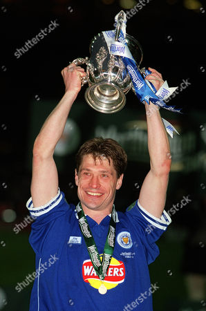 Tony Cottee (Leicester City) holds aloft the League Cup his 1st Trophy in a career of nearly 20 years Leicester City v Tranmere Rovers Worthington League Cup Final Wembley Stadium 27/2/2000 Great Britain London