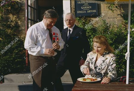 Christopher Chittell (as Eric Pollard) and Siv Borg (as Toril, Norwegian dignatory to twin towns) with Richard Thorp (as Alan Turner) (Episode 1590 - 11h September 1991)