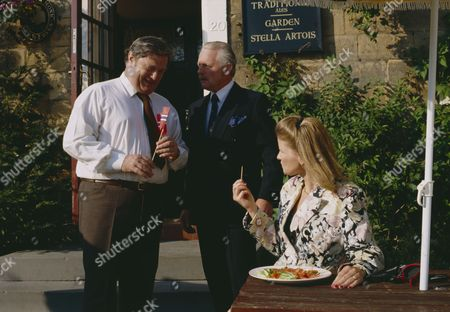 Stock Photo of Christopher Chittell (as Eric Pollard) and Siv Borg (as Toril, Norwegian dignatory to twin towns) with Richard Thorp (as Alan Turner) (Episode 1590 - 11h September 1991)