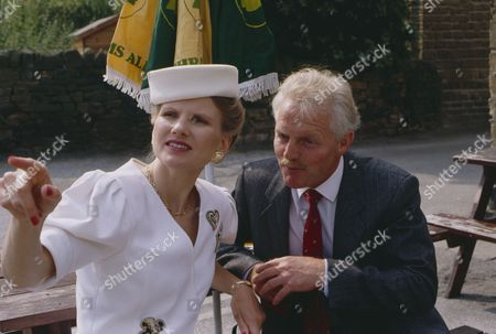 Stock Picture of Christopher Chittell (as Eric Pollard) and Siv Borg (as Toril, Norwegian dignatory to twin towns) (Episode 1590 - 11h September 1991)