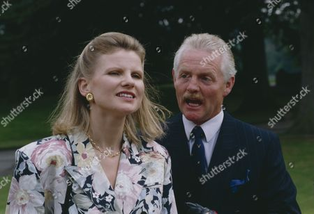 Stock Image of Christopher Chittell (as Eric Pollard) and Siv Borg (as Toril, Norwegian dignatory to twin towns) (Episode 1590 - 11h September 1991)