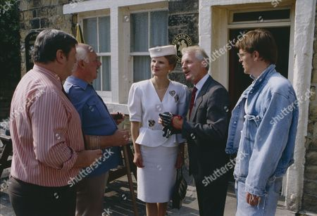 Stock Picture of Christopher Chittell (as Eric Pollard) and Siv Borg (as Toril, Norwegian dignatory to twin towns) with Richard Thorp (as Alan Turner) and Arthur Pentelow (as Henry Wilks) (Episode 1590 - 11h September 1991)