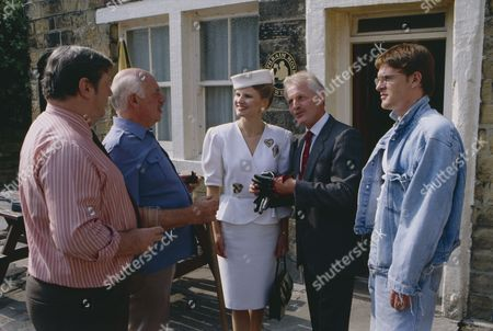 Stock Image of Christopher Chittell (as Eric Pollard) and Siv Borg (as Toril, Norwegian dignatory to twin towns) with Richard Thorp (as Alan Turner) and Arthur Pentelow (as Henry Wilks) (Episode 1590 - 11h September 1991)