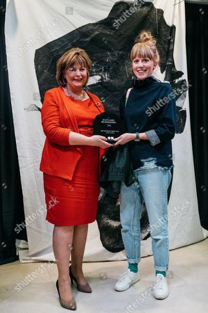 Stock Photo of SRD Interiors Award Winner - Laura Spring being presented by Fiona Hyslop MSP