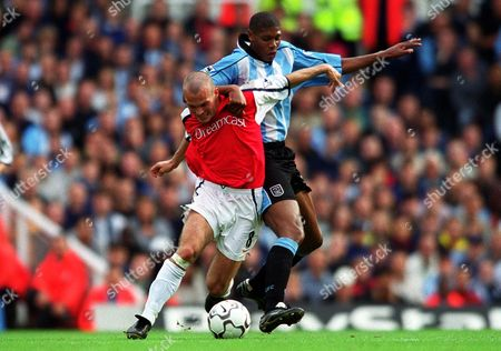 Stock Picture of Fredrik Ljungberg (Arsenal) Carlton Palmer (Coventry City) Arsenal 2:1 Coventry City F A Carling Premiership 16/9/2000 Great Britain London