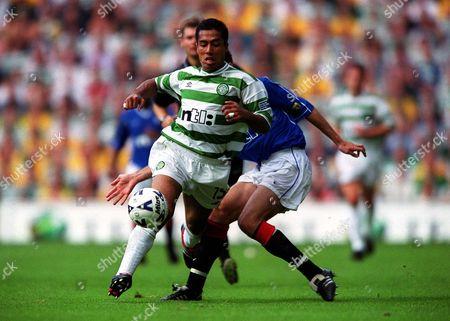 Stock Picture of Bobby Petta (Celtic) Tony Vidmar (Rangers) Celtic 6:2 Rangers Scottish Premier League Celtic Park Glasgow Scotland 27/8/2000 Great Britain Glasgow