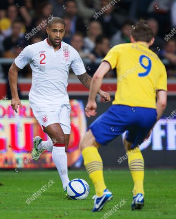 Stock Photo of Football - 2012 / 2013 International Friendly - Sweden vs England England 2 Glen Johnson tries to get past Sweden 9 Kim K?llstr?m Kallstrom ()  Football Friendly Game Sweden England Sweden Solna