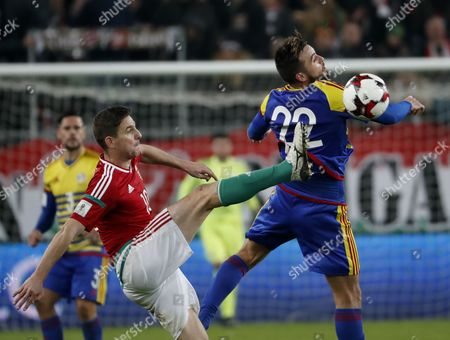 Zoltan Gera (L) of Hungary battles for the ball in the air with Victor Rodriguez #22 of Andorra