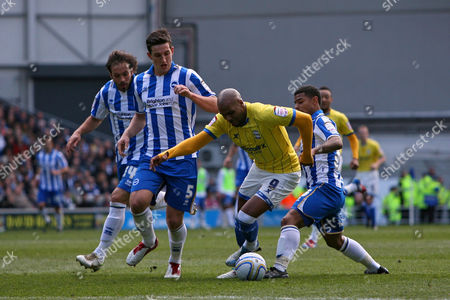 Football - The Championship - Brighton and Hove Albion vs Birmingham City Marlon King of Birmingham City tries to force his way past Brighton's Liam Bridcutt and Lewis Dunk
