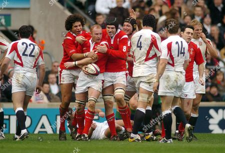 Martyn Williams (Wales) celebrates his try with Michael Owen and Colin Charvis (left) England v Wales Twickenham 4/2/2006