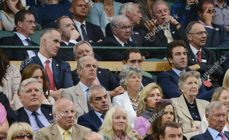 Tennis - 2014 Wimbledon Championships - Week Two Monday Mens Singles Third Round: Andy Murray v Kevin Anderson Ex Tennis stars Justin Gimelstob (back right) and Todd Martin (back left) in the Royal Box on Centre Court